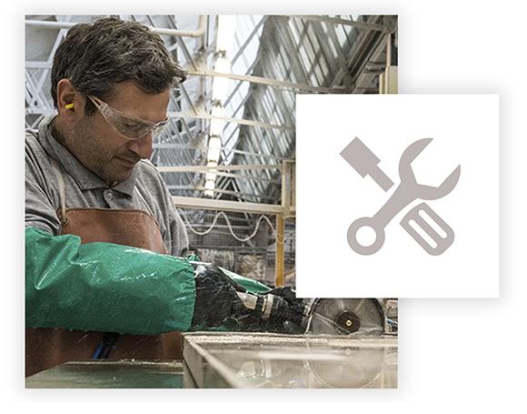 Arenastone craftsman in workshop polishing quartz worktop