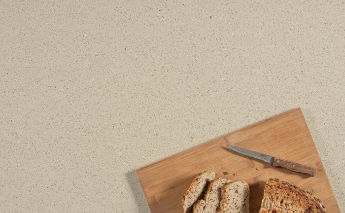 Arenastone Crema Stelline N - bread on breadboard