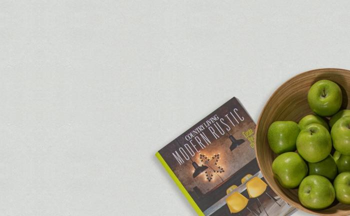Arenastone Bianco Concreto - prop shot - bowl of apples